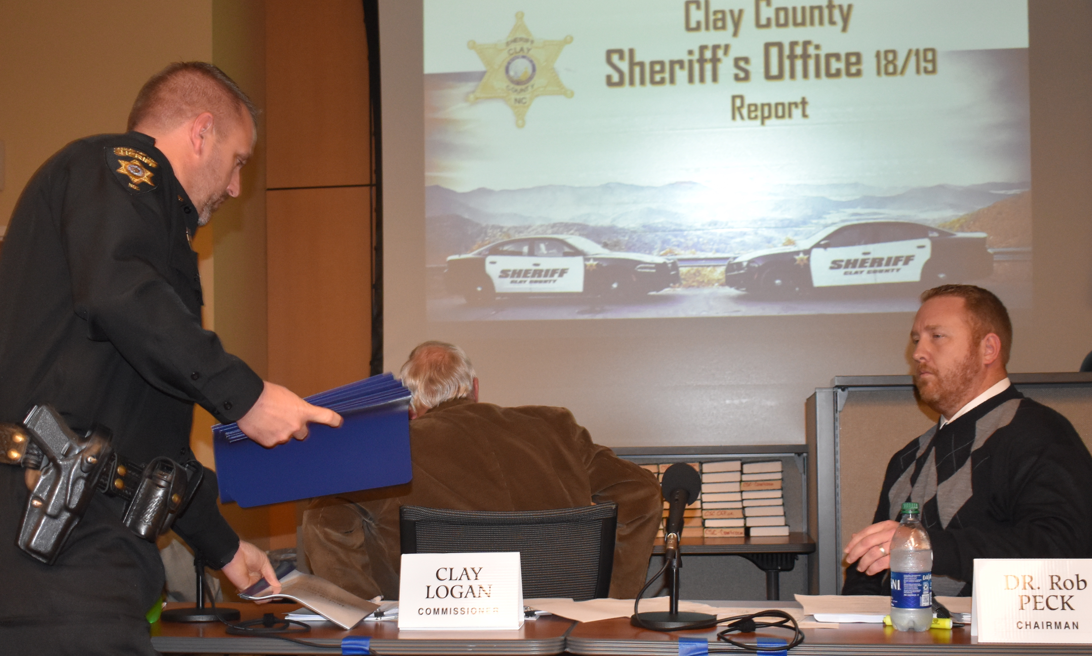 (Becky Long • Clay County Progress) Clay County Sheriff Bobby Deese hands out reports to the commission board including Chairman Rob Peck during a Feb. 6 meeting. Deese provided a statistical update of his first year in office.