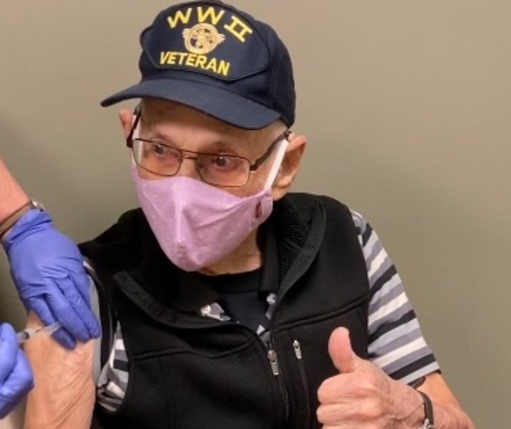 World War II veteran Ash Rothlein receives his second Moderna vaccination at the Clay County Health Department on Thursday. Rothlein, 96, is a recipient of the French Legion of Honor. He has dedicated much of his life to honoring those who died on the beaches of Normandy