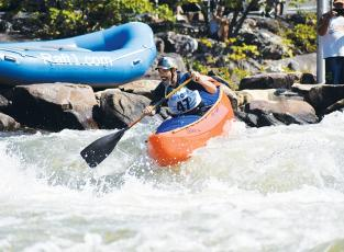 Shawn Malone heads down the Ocoee River across the state line in Tennessee on a test run of the slalom course for the second annual Ocoee River Championships on Friday morning.
