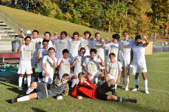 (Karen Dudley • Submitted)  Hayesville's men's soccer team celebrate their SMC championship after their win over Swain. First row, from left, Connor Rexroad and Kylan Bunch. Second row, Jose Constantino, Je erson Hernandez, Will Gordon, Javier Bustamante, Lee Anderson, Ayeden Richbourg and Blake Owens.Third row, Anthony Ashley, Isaiah Michael, Jacob Rogers, Mason Norris, Jared Welch, Zane Lucksavage, David Green, Ryelan Snowden and Omar Fonceca.
