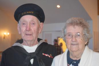 "(Progress photo by Lorrie Ross)  A Navy veteran of World War II, Hoke Henson of Peachtree, led the Pledge of Allegiance during the 2018 Veteran's Day ceremony and stood proudly with his wife after the solemn service. Hoke Henson was Navy Fire and Rescue. As they posed for the picture, Edith Henson smiled and said, ""We have been married 71 years."""