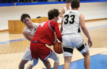 (Photo by Kelli Graves / Clay County Progress) Junior Blake McClure fights for the ball in the first round of the Battle of the States tournament.