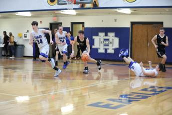 (Kelli Graves * Clay County Progress) Jake McTaggart leaves an Eagle in his wake as he rumbled up the floor.