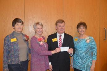 (Lorrie Ross • Clay County Progress) Erlanger Western Carolina CEO Mark Kimball accepts a check for $72,550 from Granny's Attic officers, from left, Sandy Jersey, Karen Robinson, Kimball and Debbie Thrower.