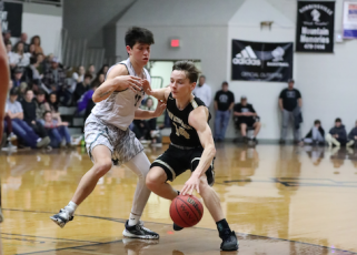 (Kelli Graves • Clay County Progress) Point guard Kolbe Ashe tries to create room to work against the Black Knights.