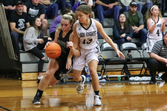 (Kelli Graves • Clay County Progress) Sophomore Lila Payne lowers a shoulder and drives past a Lady Knight and towards the basket.