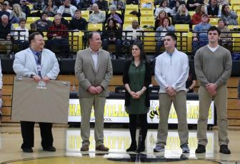 (Kelli Graves • Clay County Progress) Hayesville head coach Mike Cottrell, flanked by HHS principal Jim Saltz to his right and wife Jenny, and sons Josh and Zach to his left, is honored for his 400th win as coach of the Yellow Jackets.