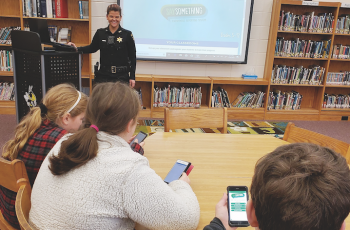Clay County Sheriff's Office School Resource Officer and District Training Coordinator Melissa Mariano trained Clay County Schools students about the Say Something Anonymous Reporting App. The student in the foreground has the app open on his phone.