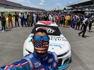 (@bubbawallace • Twitter) Bubba Wallace snaps a picture as fellow drivers and crew members show support for the Alabama native.