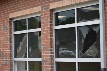 (Becky Long / Clay County Progress) Workers arrived at the Hayesville Primary School Tuesday morning to find multiple broken windows on the new Building.