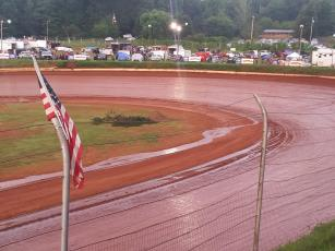 Travis Dockery • Clay County Progress A stream runs off the high banks and into the infield after a passing shower soaked the Brasstown Bullring.