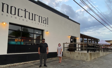 •Curt Wheeler Mike Plummer, owner of Nocturnal, gave Sherry Adams, of the North Carolina Department of Commerce, a tour of his building which was renovated with help from the Solutions Fund available through North Carolina Small Town Main Street.
