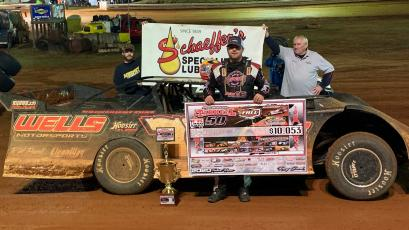 "Brandon Overton stands in victory lane after winning his second consecutive ""Tarheel 50."" (Cole Perkins • Photo submitted)"