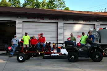 Shooting Creek members, from left, Jon Ashe, Joe Davenport, Lynn Trocchia, Pete Trocchia, Stanley Robinson, Tom Bussolari and Wade Moss admire the new rescue ATV and stokes basket trailer.