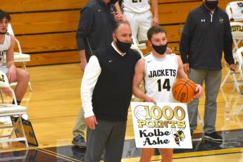 (Travis Dockery • Clay County Progress) Coach Mike Cottrell takes a moment to recognize Kolbe Ashe's 1000th point accomplisment. Ashe would go on to have a career-high 34 points in the playoff game win.