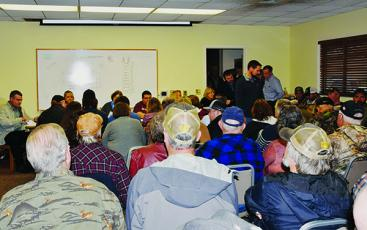 The meeting room, hallway and lobby of the Graham County Public Library were packed Feb. 5, when the Town of Robbinsville once again discussed the possibility of putting alcohol sales on the ballot. Photo by Art Miller/amiller@grahamstar.com