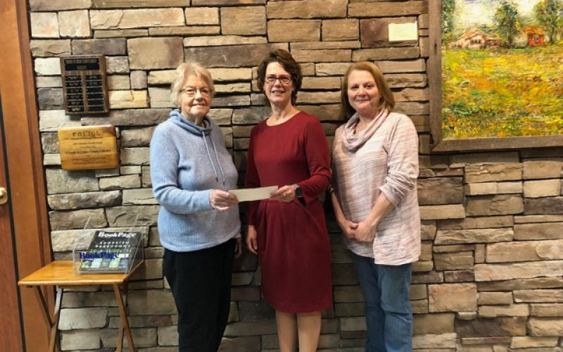 DAR presents a $500 donation. Sandie Harbuck, Chapter Librarian and Cayce Friedly, Corresponding Secretary, both of Blairsville, presented a check to Carol Knight, center, Principal of Woody Gap.
