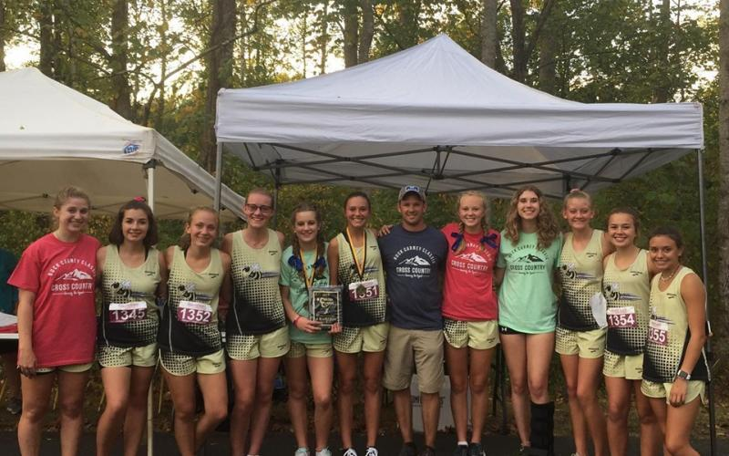 Colleen Urbaniuk • Submitted  //  The Lady Yellow Jackets celebrate the Carney Classic victory. From left, Allison Thomas, Meg Barton, Samantha Moral, Leah Hatherly, Caroline Burch, Kayson Krieger, coach Zach Moss, Cecilia Jones, Elizabeth Beck, Serina Penland, Lila Roberts and Meadow Rose.