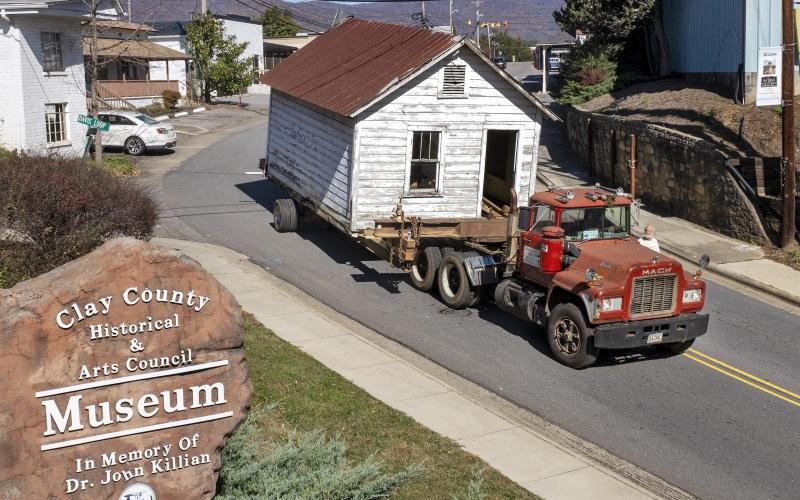 The old Hayesville Town Hall came slowly down Main Street on equipment provided by Smith House Movers.