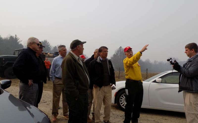 (Progress photo by Lorrie Ross)   Then NC Governor Pat McCrory made a Sunday morning trip to Clay County to see the fires in person. The forestry department's incident command personnel point out Shooting Creek firelines from a safe distance.