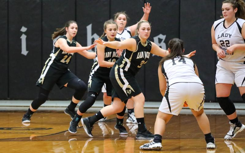 The trio of Annessca Guyette, Lila Roberts and Kaylee Leath- erwood clog the lane against Robbinsville.