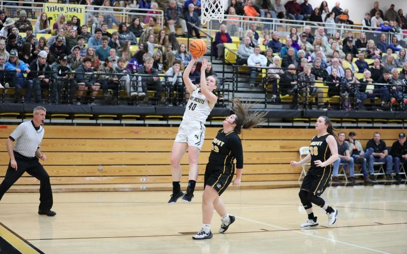 Kelli Graves • Clay County Progress Kynnly McClure attacks the basket as the Lady Jackets try to rally against the No.1 team in the state.