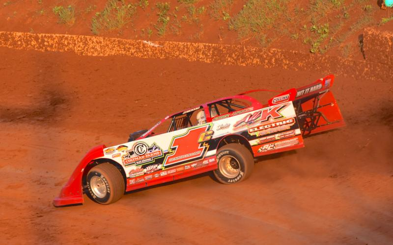 (Travis Dockery • Clay County Progress) Eventual Super Late Model winner Kenny Collins hits the high line during practice laps at Tri County Racetrack.