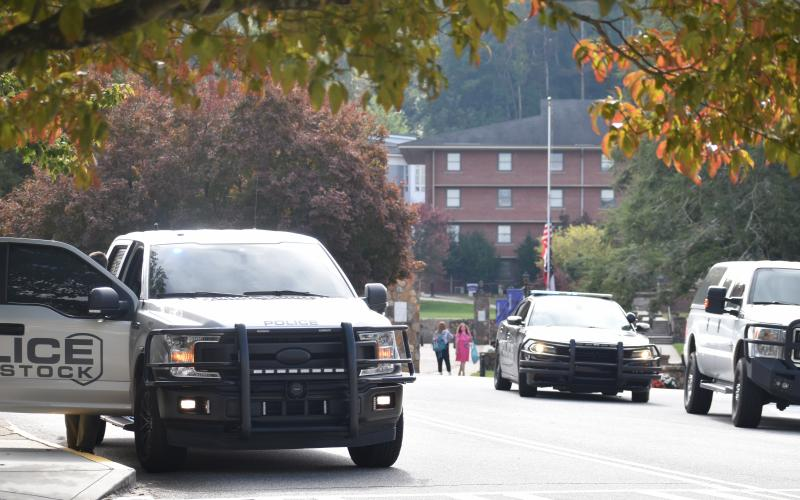 (Becky Long • Clay County Progress) Towns County Sheriff's officers and other law enforcement agencies block entrances to Young Harris College Monday afternoon.