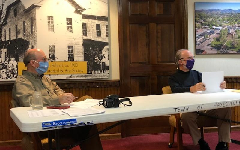 (Lorrie Ross•Clay County Progress) Mayor Harry Baughn and Councilman Joe Slaton discuss the new parking stripes and lights for town